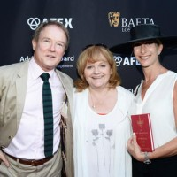 Actress Lesley Nicol (C) and guests