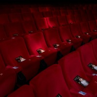 Brochures line the seats ahead of Willimon's Screenwriters' Lecture