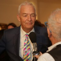 BAFTA Fellowship recipient Jon Snow happily sporting a colourful, geometric tie.