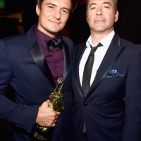 Orlando Bloom and Robert Downey Jr. pose for a picture after leaving the stage