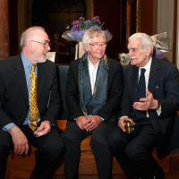 Peter Egan, Sir Tom Courtenay and Omar Sharif chat over a drink at the reception.