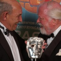 Lord Richard Attenborough CBE presenting the  BAFTA Special Award for Outstanding Contribution to Television, to John Ogwen, at the 2004 BAFTA Cymru Awards.