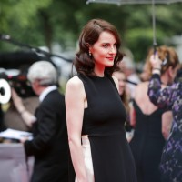 Michelle Dockery poses for photographers on the red carpet.