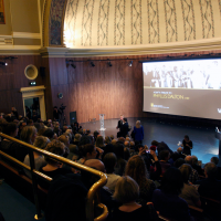 The crowds wait in anticipation in the V&A auditorium.