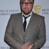 BAFTA-winning performer Danny Wallace stands on the red carpet of British Academy Children's Awards in 2014