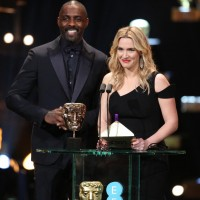 Idris Elba and Kate Winslet take to the stage to present the first award of the night for Outstanding British Film