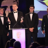 The League of Legends team accept the award for Persistent Game at the British Academy Games Awards Ceremony in 2015