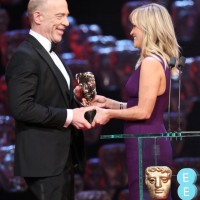 Reese Witherspoon presents the award for the Supporting Actor to J.K Simmons for his performance in Whiplash