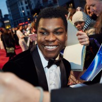 EE Rising Star nominee John Boyega greets fans on the red carpet