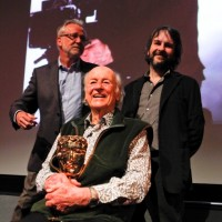 Tony Dalton, Ray Harryhausen with his award, and  Peter Jackson on stage after the event (BAFTA/Brian J Ritchie).