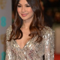 Gemma Chan looks radiant as she poses for the cameras on the red carpet