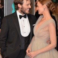 Sam Claflin and Laura Haddock arrive on the red carpet