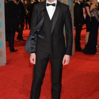 Tom Hughes arrives on the red carpet