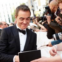 Leading Actor nominee James Nesbitt signs an autograph for a fan