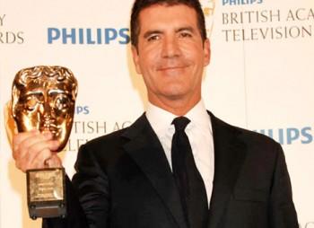 Simon Cowell poses with his Special Award BAFTA (BAFTA/Richard Kendal).