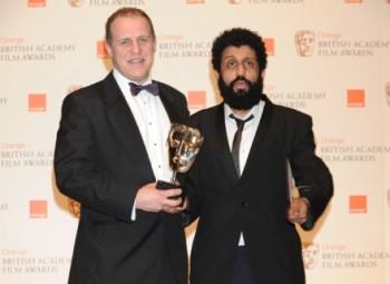 Four Lions actors Nigel Lindsay and Adeel Akhtar collect Chris Morris' BAFTA. (Pic: BAFTA/Richard Kendal)