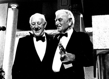 Sir Alec Guiness celebrates his Academy fellowship with Sir David Lean in 1989.
