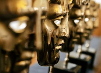 BAFTA masks wait to be presented at the Orange British Academy Film Awards.