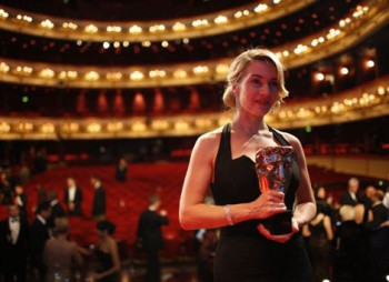Kate Winslet clutches her Best Actress BAFTA in the Royal Opera House, Sunday 8 February, 2009..