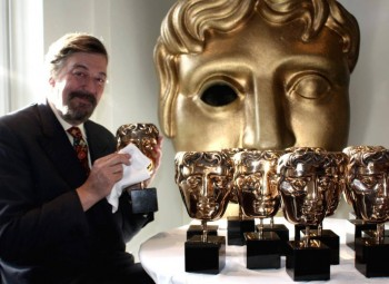 Stephen Fry with BAFTA masks