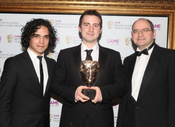 Presenters Reece Ritchie and Andrew Oliver with the Gameplay winner. SMG2 was praised by the jury for its smooth and simple controls and excellent open structure. (Pic: BAFTA/Steve Butler)
