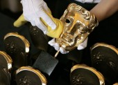 BAFTA masks are polished before the Orange British Academy Film Awards (BAFTA/Marc Hoberman).