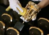 BAFTA masks are polished before the Orange British Academy Film Awards (BAFTA/Marc Hoberman).
