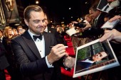 Leonardo DiCaprio signs autographs for fans on the red carpet
