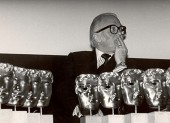 Richard Attenborough waits backstage with the coveted BAFTA Masks at the Television Craft Awards.