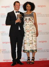 Dominic West celebrates his BAFTA win for Appropriate Adult alongside award presenter Sophie Okonedo.