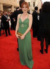 Her elegant, full-length gown in a soft shade of sage green that beautifully compliments her autumnal colouring. Her slim figure suits this empire line style, which must be avoided at all costs if you have a tummy, as it can look like a maternity dress. K
