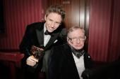 Leading Actor winner Eddie Redmayne poses backstage with Stephen Hawking at London's Royal Opera House.