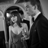 Presenters of the Outstanding Debut Award Dakota Johnson and Will Poulter relax backstage at London's Royal Opera House