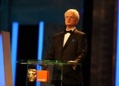 Tim Corrie makes his opening address at the top of the show. (Pic: BAFTA/Stephen Butler)